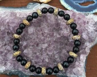 Black and sparkly gold bracelet