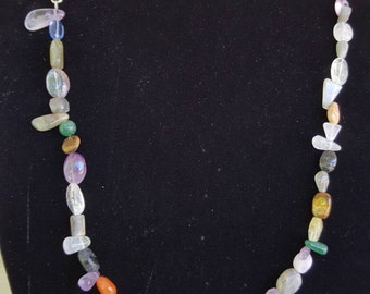 Handmade, mixed, real gemstones necklace on a silver plated chain.