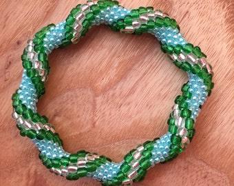 Spiral waves blue, green bangle