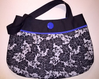 Blue, gray, and black pleated purse