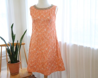 Glittery peach 1960s party dress