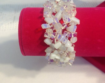 White mother of pearl chips.Stretchable bracelet