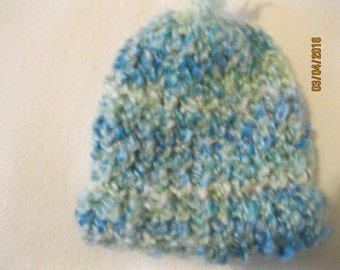 blue and green fuzzy baby hat