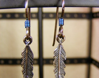 Sterling silver feather earrings with blue coil