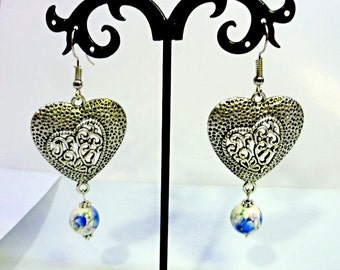 heartshaped Earrings with filigree and porcelan beads