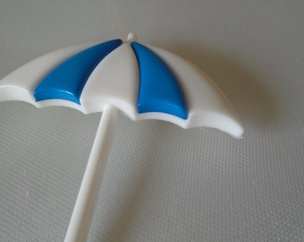 plastic blue and white umbrella brooch