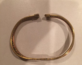 Beautiful twined copper and gold bracelet