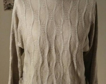 Taupe coloured knitwear with silver thread.