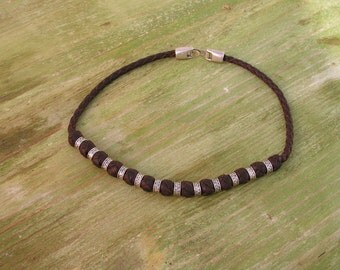 64. Leather necklace with clasp and zamak embellishments