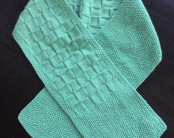 Hand Knit Mint Green Colored Scarf with an Asymetrical Half Basket Weave and Half Pearled Knit Design