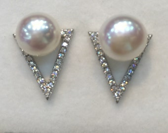Large pearl stud earrings set in sterling silver and accented by crystals