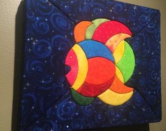 Fabric on styrofoam wall art.