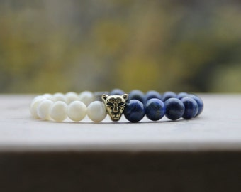 Bracelet with head cheetah golden in semiprecious stones white and blue lapis.