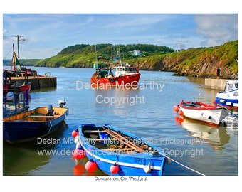 Bringing home the catch, Duncannon Pier, red boat's return