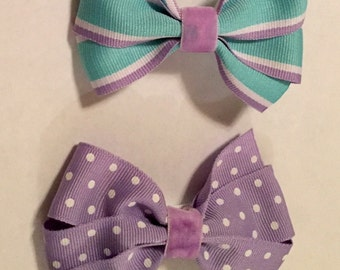 2 teal and purple bows with alligator clips