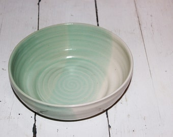 green and white ceramic serving dish