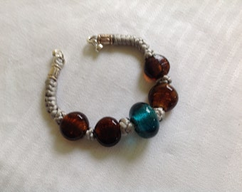 Hand knotted bracelet punctuated with large glass beads