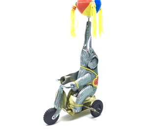 Vintage wind up elephant on tricycle toy,win-up tin toy, collectible tin windup miniature, wind up toy,retro collection,tin circus