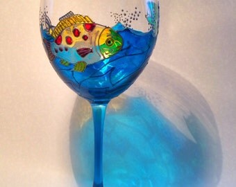One fish two fish! Three colorful fish swim around this hand painted wine glass. Brilliant colors!
