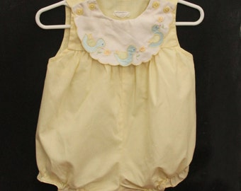 Butter yellow romper with bluebird details