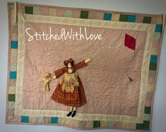 Patchwork 3D wall hanging featuring quilted background