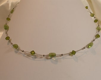 Beaded necklace with Peridot and green Swarovski Crystal.