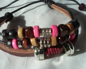 Handmade leather braided and beaded bracelet with pink accents