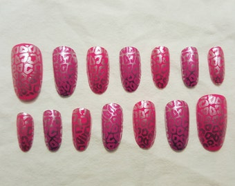 Pink leopard print design. Oval shaped, hand-painted false nails.