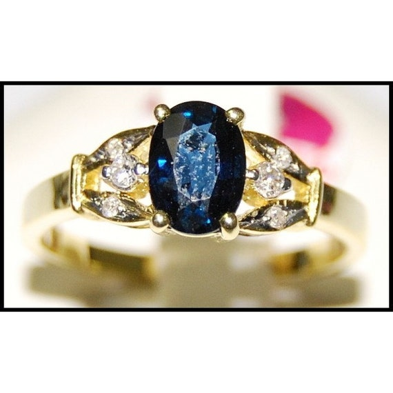 Diamond 18k yellow gold oval solitaire blue sapphire ring for Sapphire studios jewelry reviews