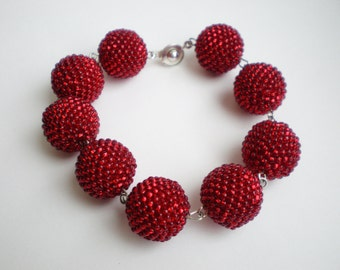 Red braided bracelet with beads beads
