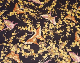E966 Onyx/Gold Butterfly Print Fabric from Hoffman Fabrics
