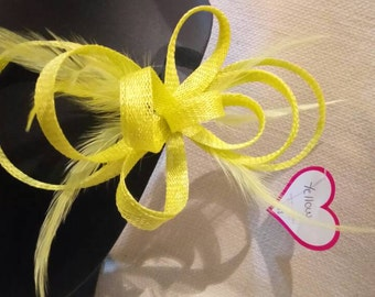 Bow Fascinator with feathers. Yellow colour.