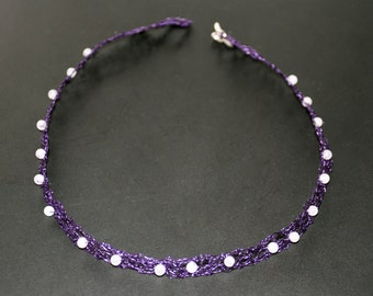 Short necklace of neck knitting of thread of purple copper and pink pearls of quartz