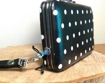 Polka dot hardcase purse.