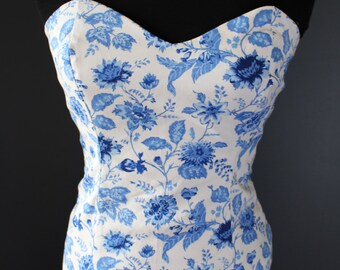 floral size 10 bustler. with a corset looking back.