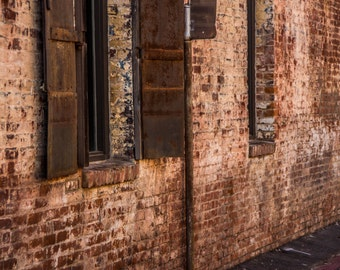Metal Shutter Windows on Brick