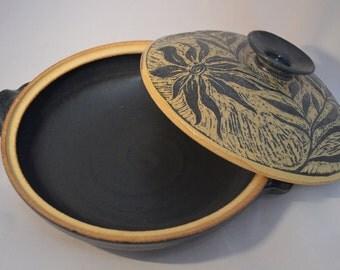 Handmade stoneware casserole with sgraffito detailing