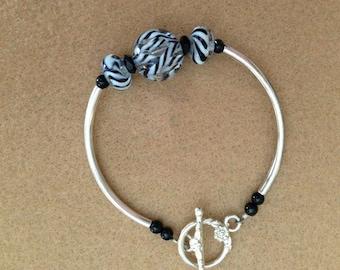 Black and white lampwork bead bracelet