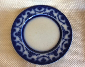 Antique New Wharf pottery semi porcelain Flow blue dinner plate