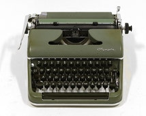 Vintage 1950s Olympia typewriter in very good working condition. German made quality and