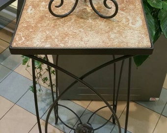 Wrought iron stand with flower