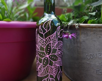 Decorated outdoor bottle with solar lights