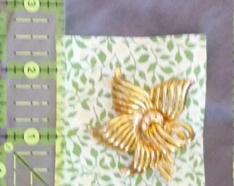 Gold-tone Spiral Flower Brooch