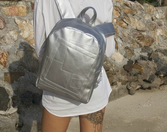 Silver backpack with pattern of geometric shapes