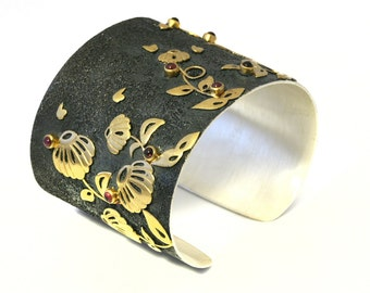 Beautiful Heavy Sterling Silver Oxidized Cuff with Garnet and Gilding reflief