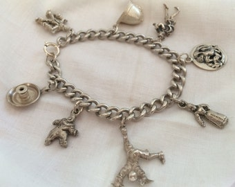 Silver Bracelet with 8 Vintage Charms