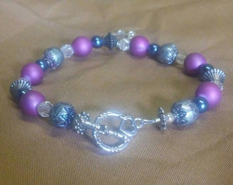 Purple, beaded, heart charm bracelet. Silver wiring, toggle clasp