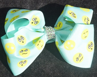 Emoji Hair Bows with rhinestone in the center. alligator clip