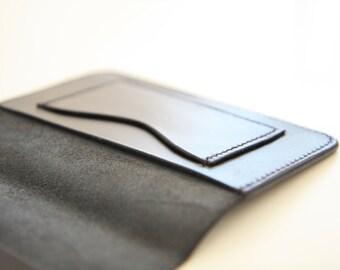 Passport cover/holder in black vegetable tanned leather.  Handstitched. Handmade.