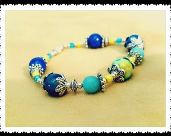 Fossil stone beads bracelet. Blue and Yellow fossil beads.